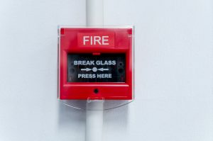 Closed-up,Of,Fire,Alarm,Press,Machine.